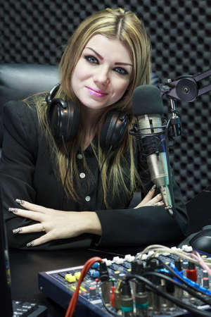 radio dj: Beautiful Woman Working As Radio DJ Live In Studio