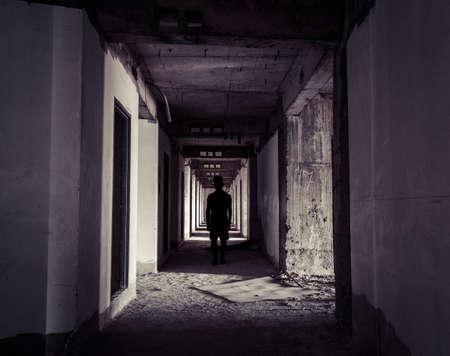 hunters tower: Ghost Hunter At Abandoned Apartment Corridor Stock Photo