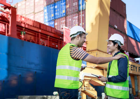 Successful Engineer Team Working At Shipping Cargo Port