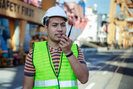 talkie: Engineer Talking On Walkie Talkie Working At Shipping Cargo Port