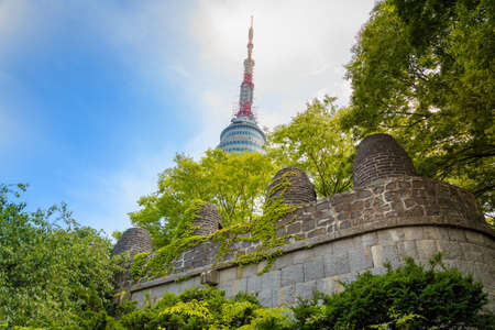 fortification: Ancient Fortification And N Seoul Tower Of South Korea Landmark Stock Photo