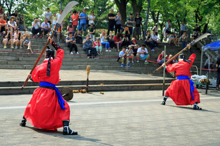 korean ethnicity: Seoul, South Korea - JUNE 09, 2015:  Tradition culture Korean guards fighting martial battle performance at N Seoul Tower in Seoul city of South Korea.