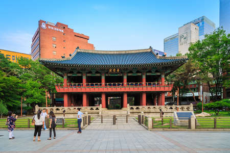 enabled: Seoul, South Korea - June 14, 2015: 14th-century tower enabled locals to tell the time, This pavilion Bosingak is a large bell pavilion on Jongno in Seoul, South Korea.