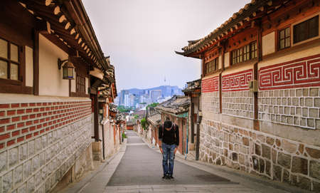 manners: Asian Man Bowing  Manners Greeting Of Korean Tradition At Traditional Old Village In Seoul City, South Korea.