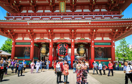 approached: Tokyo, Japan, May 12, 2016: Sensoji buddhism temple, popular temple in Tokyo. The temple is approached via the Nakamise, with shopping street, providing tourist.