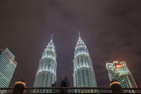 petronas: Night scene with crowd people watching lights show of Petronas Twin towers at Suria KLCC fountain, Kuala Lumper, Malaysia.
