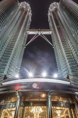 petronas: Close up Petronas Twin towers at Night scene with crowd people watching city view from bridge viewpoint, Kuala Lumper, Malaysia. Editorial