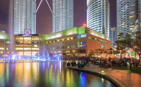 petronas: Kuala Lumpur, Malaysia - October 29, 2016: Night scene with crowd people watching lights show of Petronas Twin towers at Suria KLCC fountain, Kuala Lumper, Malaysia.