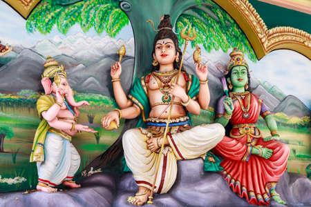parvati: Kuala Lumpur, Malaysia - 30 October 2016: Traditional statues of Hindu Gods family in Sri Mahamariamman Indian Temple China town. Editorial