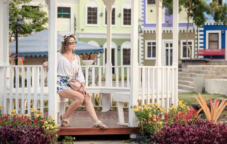 Young Caucasian Woman Sit Inside Pavilion At The Park Alone photo