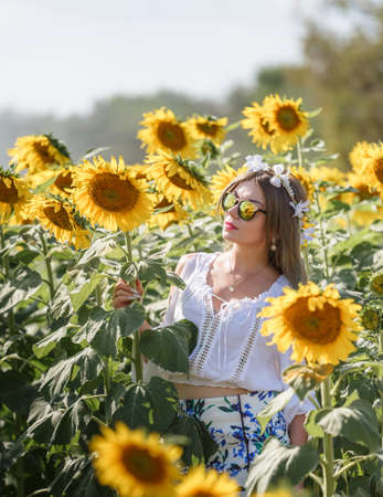 Woman In Sunflower Field With Blue Sky photo