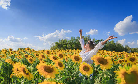 Happy Woman In Sunflower Field With Blue Sky photo