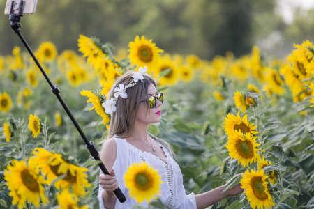 Woman Selfie In Sunflower Field With Blue Sky photo