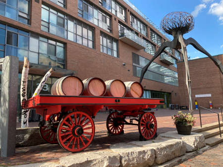 Toronto, Ontario / Canada - june 29 2020: Photography of an vintage old wagon cart carrying wooden barrels in the historic distillery district of toronto.