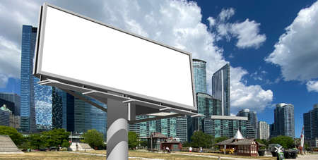 Photography of a billboard with a cityscape skyline of downtown Toronto. Can be used for marketing mockups or outdoor advertising simulations or photomontage for out of home marketing.
