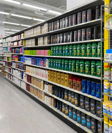 Photography of a generic supermarket aisle or grocery store aisle showing shelves filled with products. Can be used as background for marketing and retail branding.