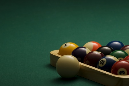 Picture of a billiard balls with triangle.