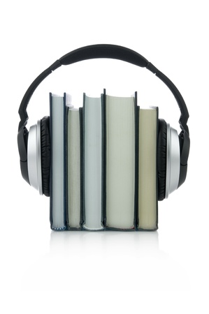 Picture of few books with headphones.