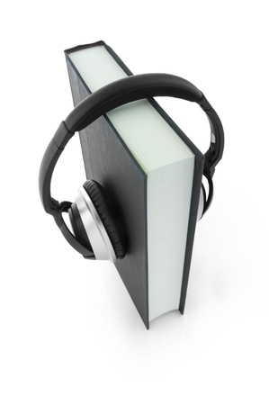 Picture of a book with headphones.