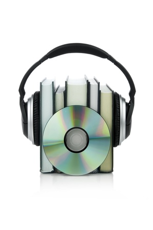 compact disk: Picture of book with headphones and a compact disk. Stock Photo