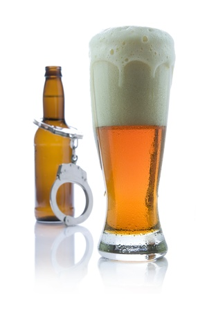 Picture of beer with handcuffs.