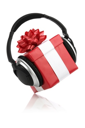 Picture of a red gift box with headphones. photo