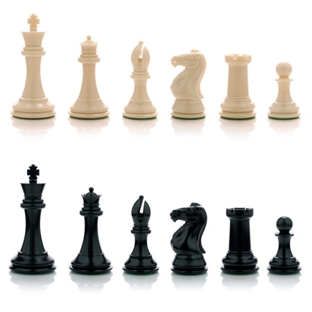 Picture of white and black chess pieces.
