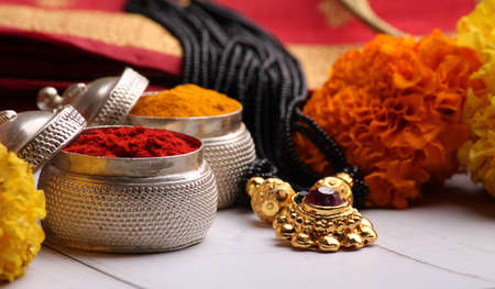oti bharne - Indian ritual of offering a sari and a blouse piece along with coconut, haldi kumkum, bangles, mangalsutra and rice. At the time of navratri to goddes or married woman. Stock Photo