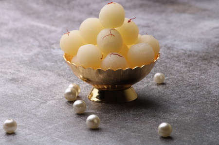 Indian Sweet Rasgulla Also Know as Rosogolla, Roshogolla, Rasagola, Ras Gulla, Anguri Rasgulla or Angoori Rasgulla is a Syrupy Dessert Popular in India. It is Madeup with milk.