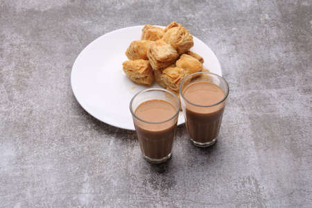 indian khari or kharee or salty Puff Pastry Snacks, served with indian hot tea.