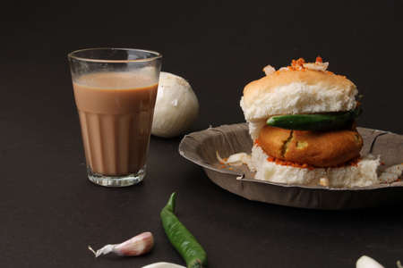 Masala cutting chai and Bombay vada paav is an indian burger. Potato patty is deep fried in gram flour or besan batter it is served hot with paav or bun like sandwich.