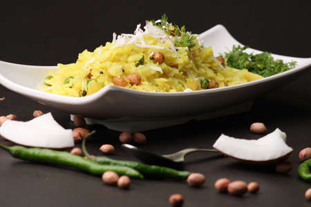 Indian Breakfast aalu Poha Also Know as kande Pohe made up of Beaten Rice or Flattened Rice.