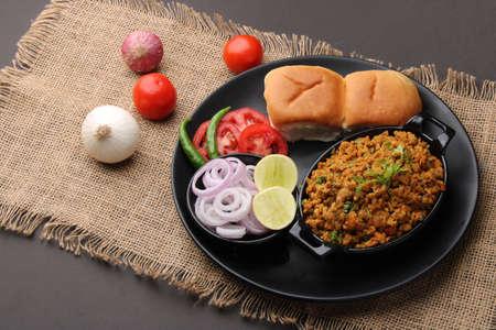 Masala Anda Bhurji or Spicy Indian scrambled eggs with bread or Bun Pav, Popular street food