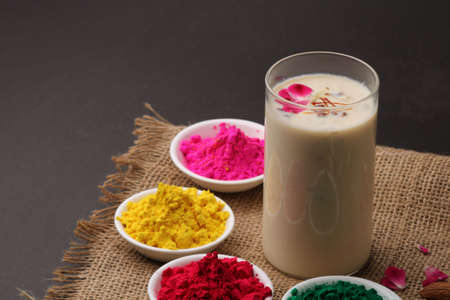 Indian festival Holi concept - Traditional Indian beverage Thandai Sardai milk festival food, with nuts and color in bowl. Imagens