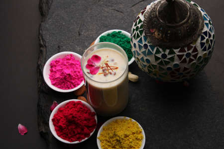 Indian festival Holi concept - Traditional Indian beverage Thandai Sardai milk festival food, with nuts and color in bowl. Stock fotó