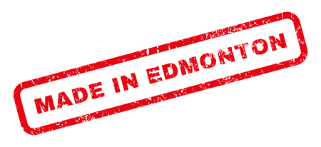 edmonton: Made In Edmonton text rubber seal stamp watermark. Tag inside rectangular shape with grunge design and scratched texture. Slanted glyph red ink sticker on a white background. Stock Photo