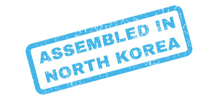 certificated: Assembled In North Korea text rubber seal stamp watermark. Tag inside rectangular banner with grunge design and unclean texture. Slanted glyph blue ink sign on a white background.