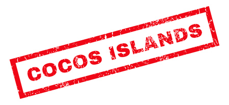 cocos: Cocos Islands text rubber seal stamp watermark. Tag inside rectangular shape with grunge design and dirty texture. Slanted glyph red ink emblem on a white background. Stock Photo