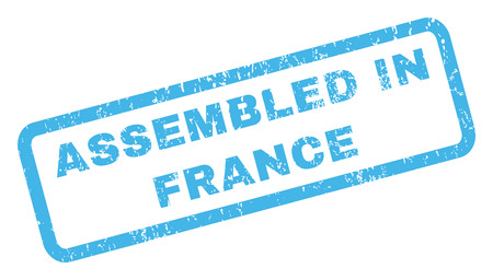 Assembled In France text rubber seal stamp watermark. Caption inside rectangular shape with grunge design and dirty texture. Inclined glyph blue ink sign on a white background.