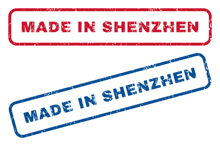 Made In Shenzhen text rubber seal stamp watermarks. Vector style is blue and red ink tag inside rounded rectangular shape. Grunge design and scratched texture. Blue and red emblems.