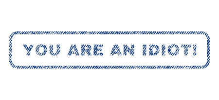 inadequate: You Are An Idiot! text textile seal stamp watermark. Blue jeans fabric rasterized texture. Raster caption inside rounded rectangular shape. Rubber emblem with fiber textile structure.