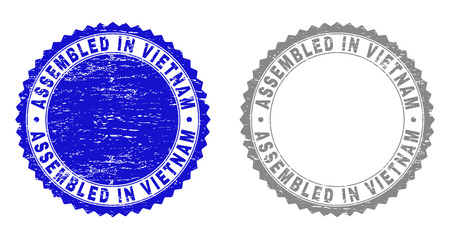 Grunge ASSEMBLED IN VIETNAM stamp seals isolated on a white background. Rosette seals with grunge texture in blue and grey colors.