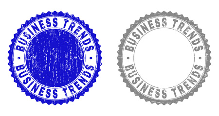 Grunge BUSINESS TRENDS stamp seals isolated on a white background. Rosette seals with grunge texture in blue and gray colors. Vector rubber overlay of BUSINESS TRENDS tag inside round rosette.