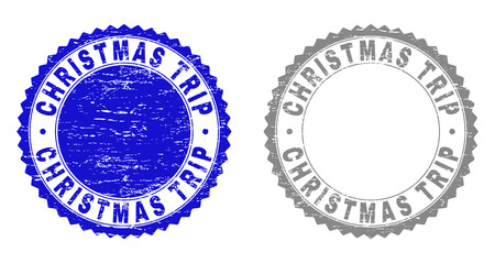 Grunge CHRISTMAS TRIP stamp seals isolated on a white background. Rosette seals with grunge texture in blue and grey colors. Vector rubber stamp imprint of CHRISTMAS TRIP tag inside round rosette.