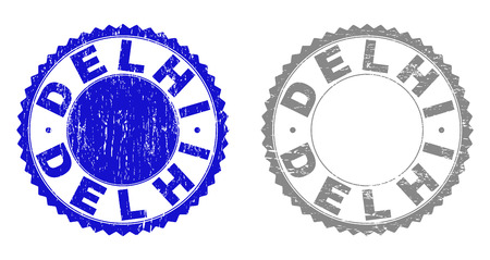 Grunge DELHI stamp seals isolated on a white background. Rosette seals with grunge texture in blue and grey colors. Vector rubber stamp imitation of DELHI label inside round rosette.