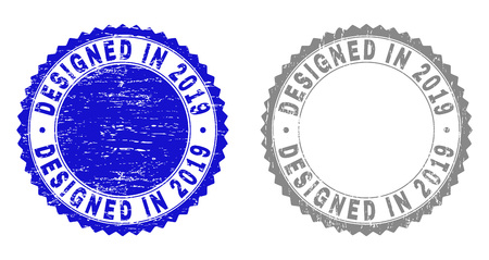 Grunge DESIGNED IN 2019 stamp seals isolated on a white background. Rosette seals with distress texture in blue and grey colors.