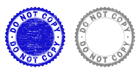 Grunge DO NOT COPY stamp seals isolated on a white background. Rosette seals with grunge texture in blue and grey colors. Vector rubber overlay of DO NOT COPY tag inside round rosette. Illustration