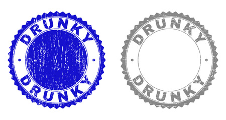 Grunge DRUNKY stamp seals isolated on a white background. Rosette seals with distress texture in blue and gray colors. Vector rubber stamp imprint of DRUNKY title inside round rosette.