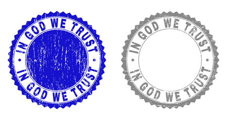 Grunge IN GOD WE TRUST stamp seals isolated on a white background. Rosette seals with grunge texture in blue and gray colors. Vector rubber watermark of IN GOD WE TRUST caption inside round rosette. Illustration