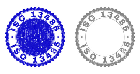 Grunge ISO 13485 stamp seals isolated on a white background. Rosette seals with grunge texture in blue and grey colors. Vector rubber stamp imprint of ISO 13485 label inside round rosette.